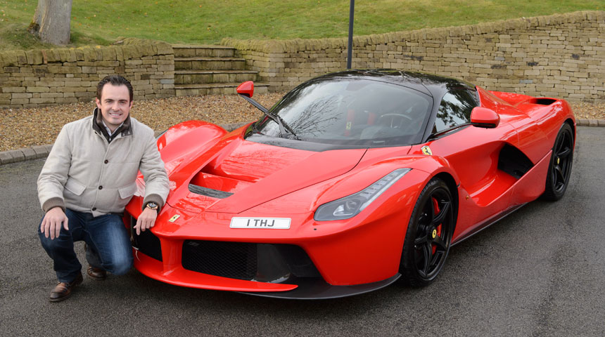 Tom Hartley Jnr with red Ferrari and 1 THJ number plate